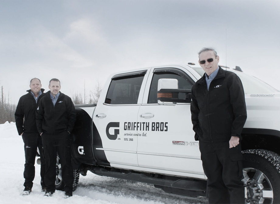 Griffith Bros. smiling staff in front of service truck
